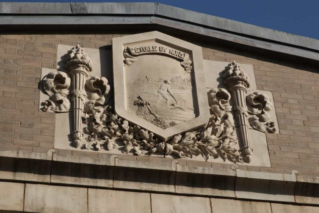 The State Seal and other touches decorate adorn the top of the powerhouse.