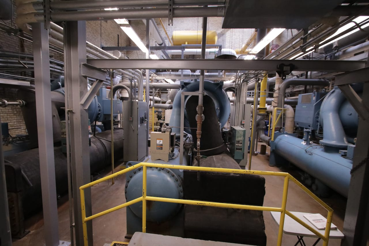 Pipes of different sizes and colors, and metal supports ran throughout the building.