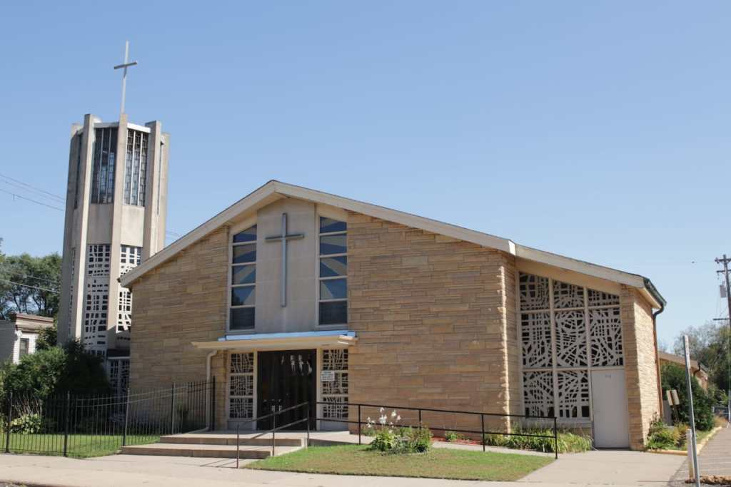 The very 1950s New Hope Baptist Church was built in 1957 for St. Ambrose Catholic Church.