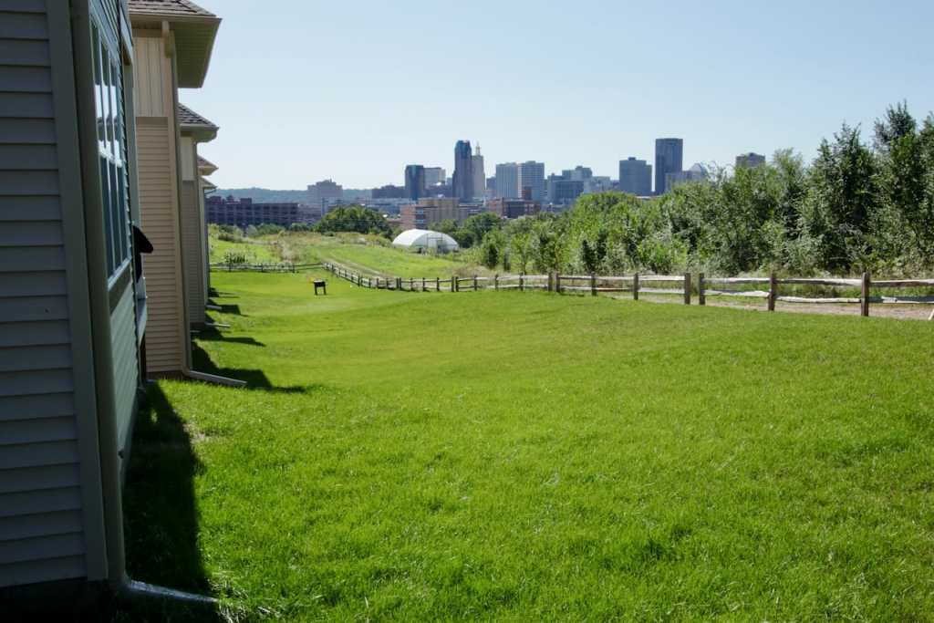This side, rather than the street-facing side of the Village homes is considered the front. Notice the skyline of Downtown to the southwest.