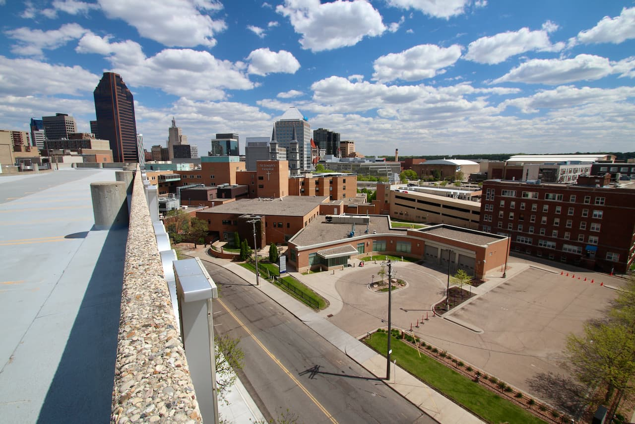 The St. Joe's Hospital complex is in the foreground in this view looking southeast. The circular driveway on the right is the now-shuttered emergency room drop-off. The heart of Downtown is in the background.