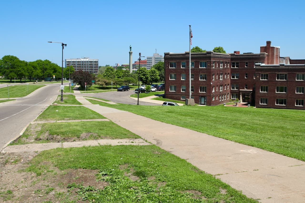 """This sidewalk along Summit Avenue is part of """"The Walkin' Man's"""" daily route."""
