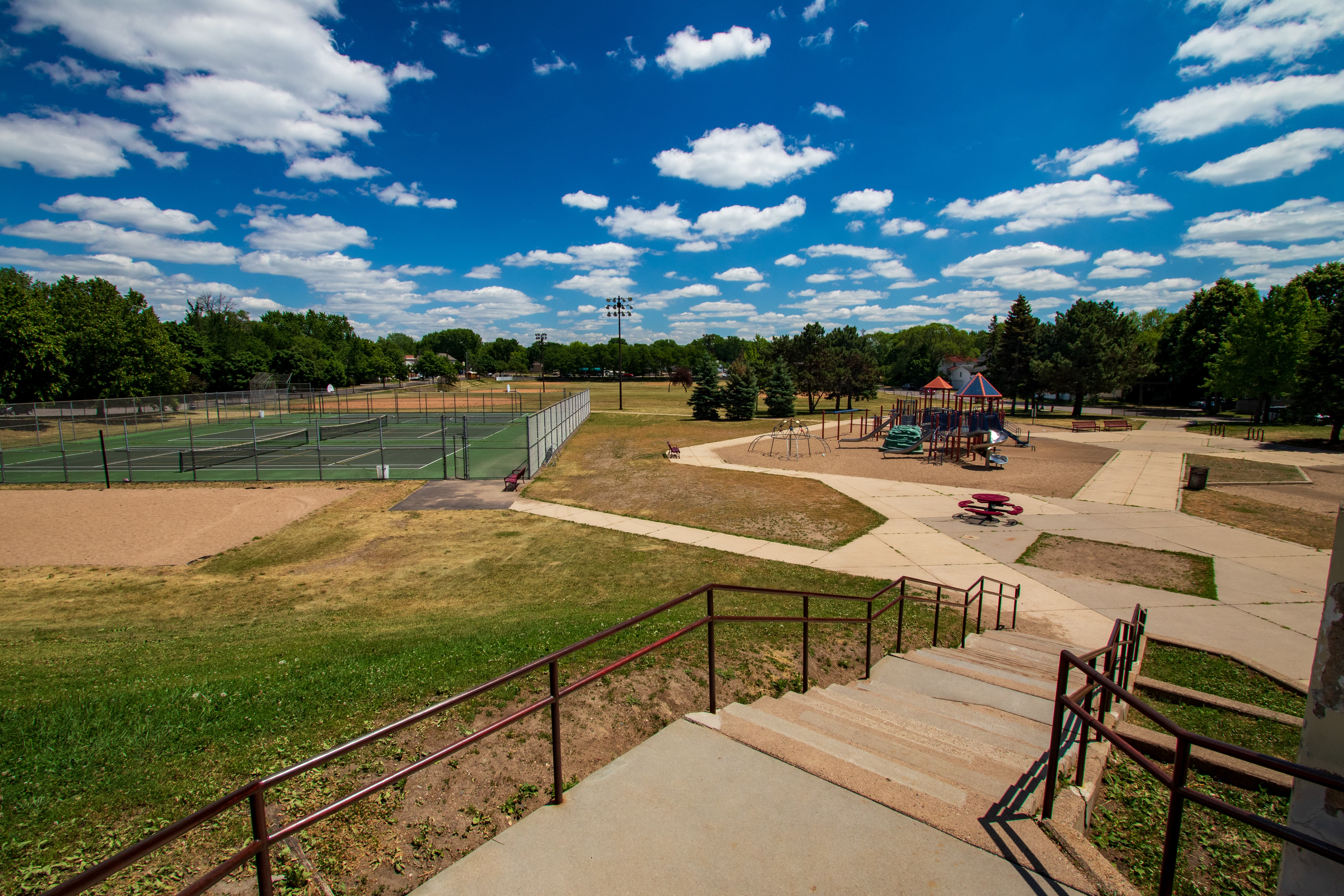 Tennis courts, playground and athletic fields are part of Wellstone Elementary property.