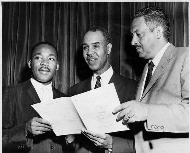 Roy Wilkins, center, with Martin Luther King, left, and Thurgood Marshall, right, at 50th anniversary of the founding of the NAACP circa 1959.
